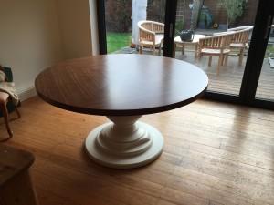 A quarter cut American oak veneered dining table crafted by Read Veneers.