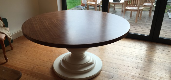 A quarter cut American oak veneered dining table crafted by Read Veneers.