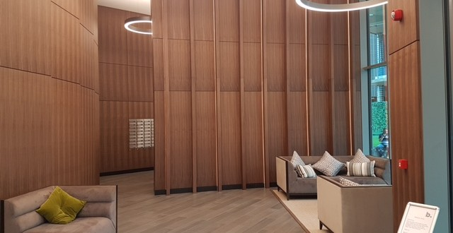 Reception panelling in quarter cut American walnut by Tagg Furniture.