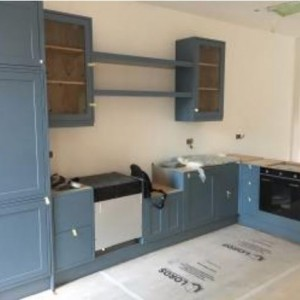 Shaker style painted finish kitchen with oak interiors